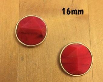 16mm red coral angled centre with with dark detailing and golden frame plugs for stretched ears