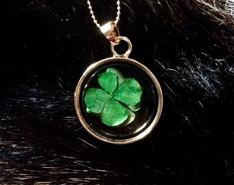 Four leaf clover floating charm pendant necklace.
