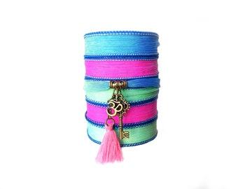 Silk ribbon wrap bracelet with key and Om charms