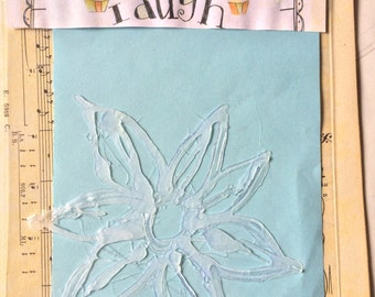 Hot glue stencils for mixed media and art journaling
