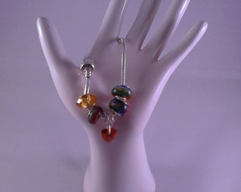 Multi-coloured charms with amber colour heart pendant charm on 19cm bracelet