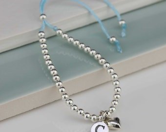 Children's Silver Bead and Cotton Thread Petite Silver Heart Friendship Bracelet Personalised with a Solid Silver Stamped Initial Charm