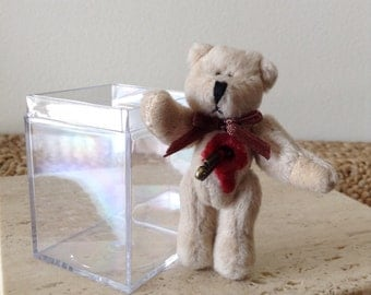 You just can't trust anyone, Teddy. Shot throught the heart with a love arrow. Handmade Bloody Mini Teddy Bear figurine in acrylic case.
