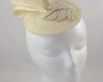 White fascinator with loop & pearl leaf embellishment