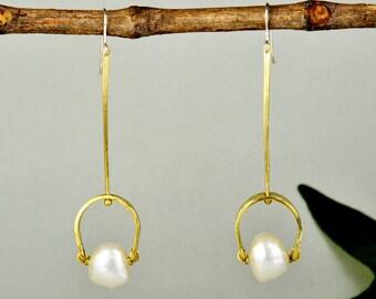 Long pearl drops, hammered earrings, minimal bridal jewelry, brass earrings, contemporary drops, white stone earrings, wedding jewelry.