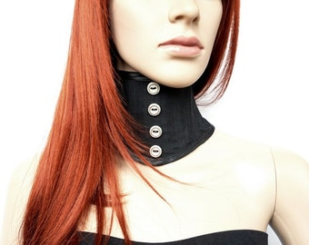 Black collar with silver decorative buttons