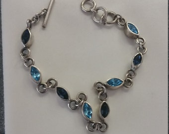 Beautiful Sterling Silver Bracelet with Blue Topaz Stones