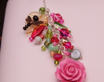 Handmade beaded pink and green rose flower planner charm with dragonfly.