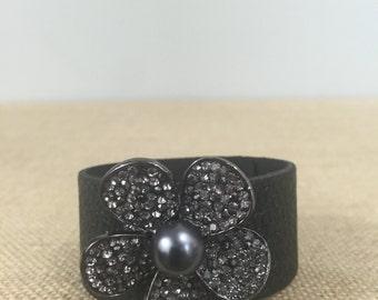 Black leather cuff with black crystal flower brooch