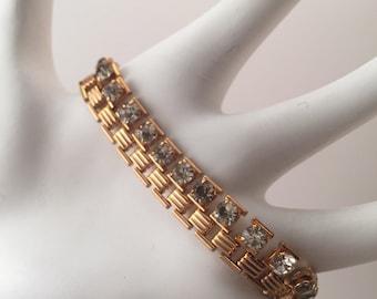 Vintage bracelet, gold metal and white rhinestones, copper colored metal
