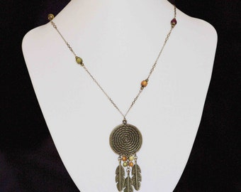 Long bronze necklace with round bronze pendant, feather and resin beads