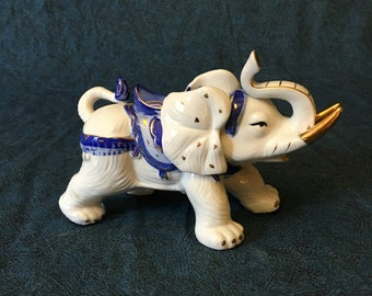 Vintage Blue and White Porcelain Elephant with Gold Trim