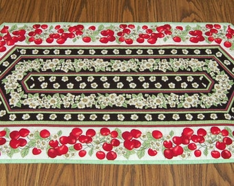 Table Runner, a handmade quilted table runner perfect for celebrating the arrival of spring and summer.