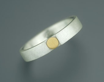 Silver ring with fine gold point