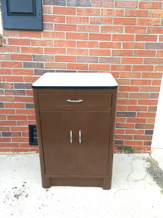 Items similar to vintage brown metal kitchen cabinet for White enamel kitchen cabinets