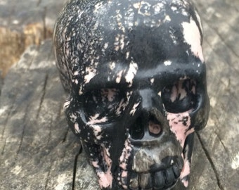 Natural Pink and Black Rhodonite Crystal Skull