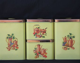 4 piece Yellow Lincoln Beauty Ware Stackable Metal Canister Set