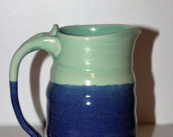Handmade large blue and light green pitcher