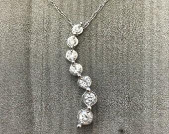 14k White Gold Diamond Journey Pendant (1/4 ct. tw.)