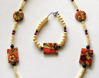 Yellow and red beaded flower necklace and bracelet set