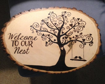 Wood burned plaque with tree