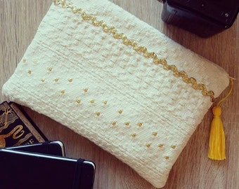 Golden, accessory pouch and bag.