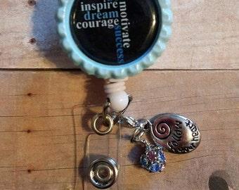 Inspirational retractable badge clip holder