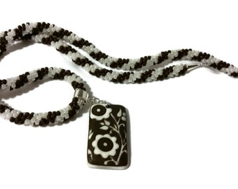 Brown & White Flower Pendant On A Kumihimo Necklace