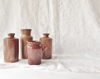 Antique Sienna Stoneware Bottle with pouring lip (pictured far left and far right)