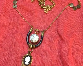 Black and gold cameo necklace