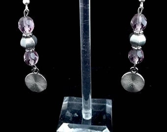 Earrings with purple beads and round pendant