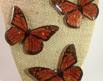 Resin and glitter monarch butterfly magnet