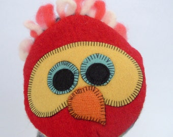 Hand puppet bird  named Penny made of seven recycled wool sweaters