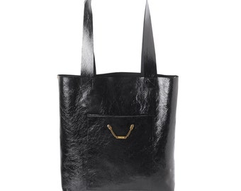 Black varnished leather shopping tote bag, with two pockets