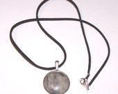 marbled gray stone pendant on velvet cord