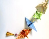 The Bright Darling origami paper art string with bead and tassel