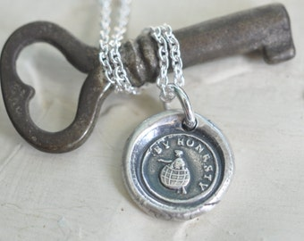 wax seal necklace with a man struggling through the world ... by honesty - fine silver Victorian trinket wax seal jewelry