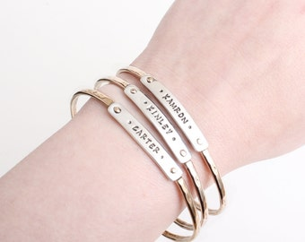 Mother's Day Gift. Stamped Name Bangle Bracelet. Personalized Mother's Bracelet by Nelle and Lizzy. Gift for Mom in silver.