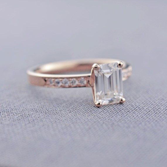 gold emerald cut engagement ring by lilyemmejewelry