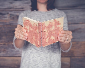 Papermaking handmade book in coral and yellow