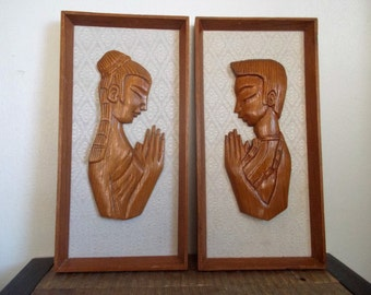 Pair of Mid Century Framed Teak Praying Man and Woman Silhouettes