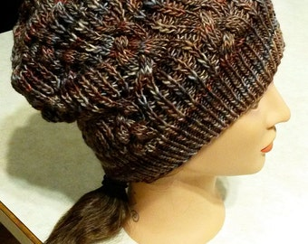 Cabled hand knit hat