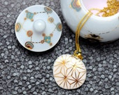 Porcelain necklace, white with gold star pattern