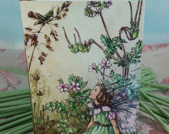 Vintage Flower Fairy Cover on Small Stitched Green and Maroon Writing Journal