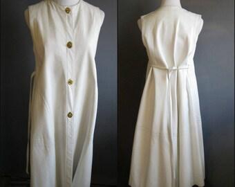 Bonnie Cashin 1960s white leather trapeze vest 60s iconic brass turnlock closures toggles Bonnie Cashin vest Cashin coat