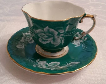Aynsley Tea Cup and Saucer; Featuring A Teal, Embossed Body Adorned With Raised White Roses And Buds circa 1950's  DS