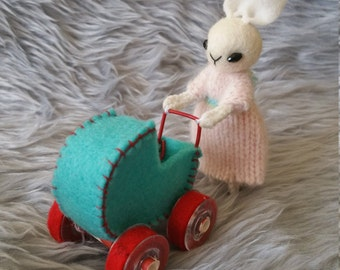 Little wool felt bunny doll with baby in a stroller