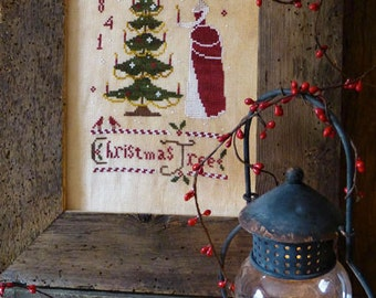 SAVE 20% OFF Christmas Tree cross stitch patterns by The Primitive Hare at thecottageneedle.com decorating the tree holidays