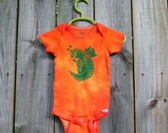 Flame orange hand stamped dragon onesie, 18 month size. 100% cotton.