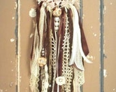 Small, vintage lace dream catcher with pearl and sheet music embellishments. Baby room, nursery, bridal shower, wedding.